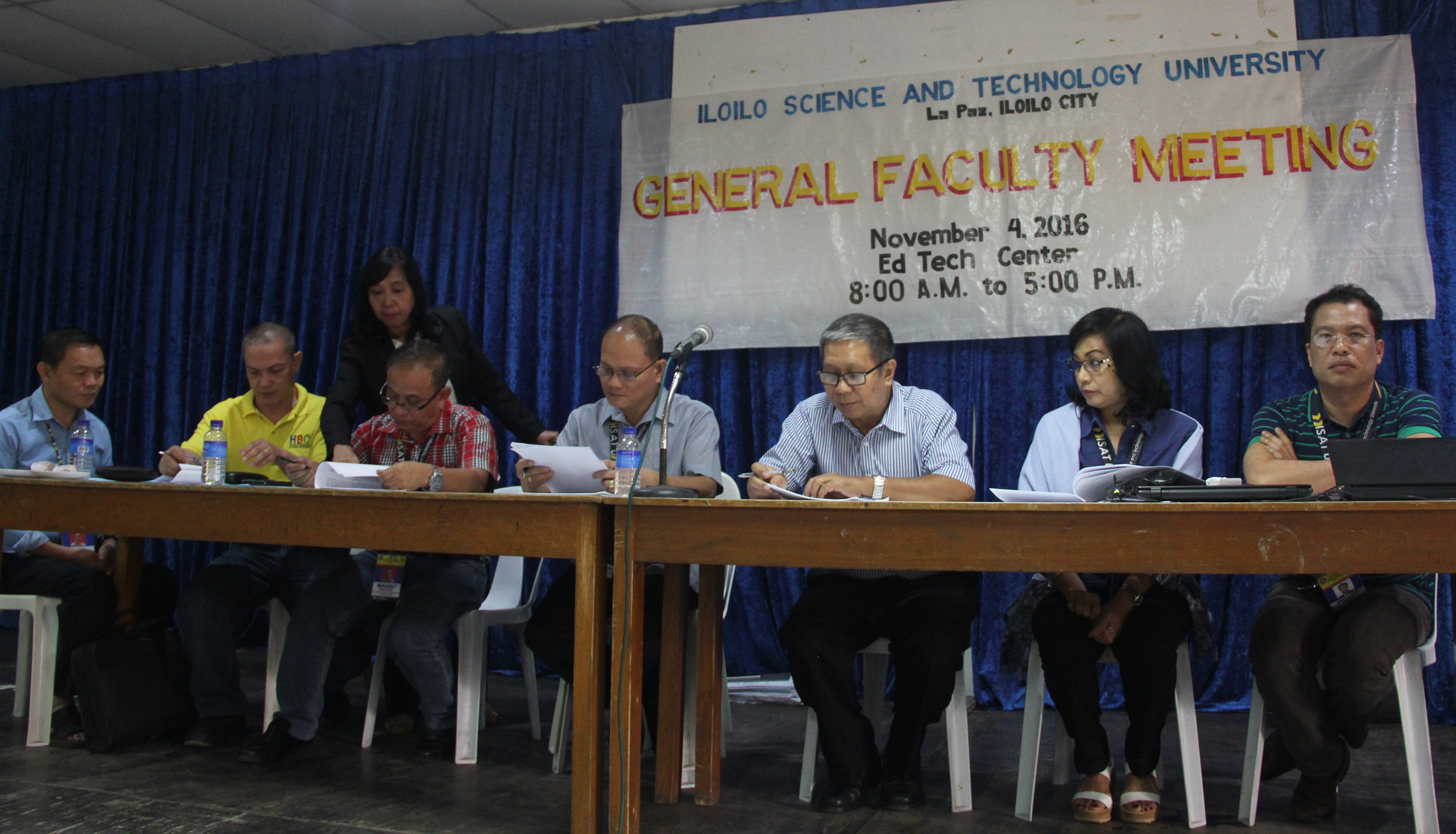 Top university officials witness the signing of the collective negotiable agreement (CNA).