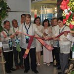 Sec. De La Pena and Engr. Rowen Gelonga with the different SUC Presidents untie the ribbon to formally open the exhibits.
