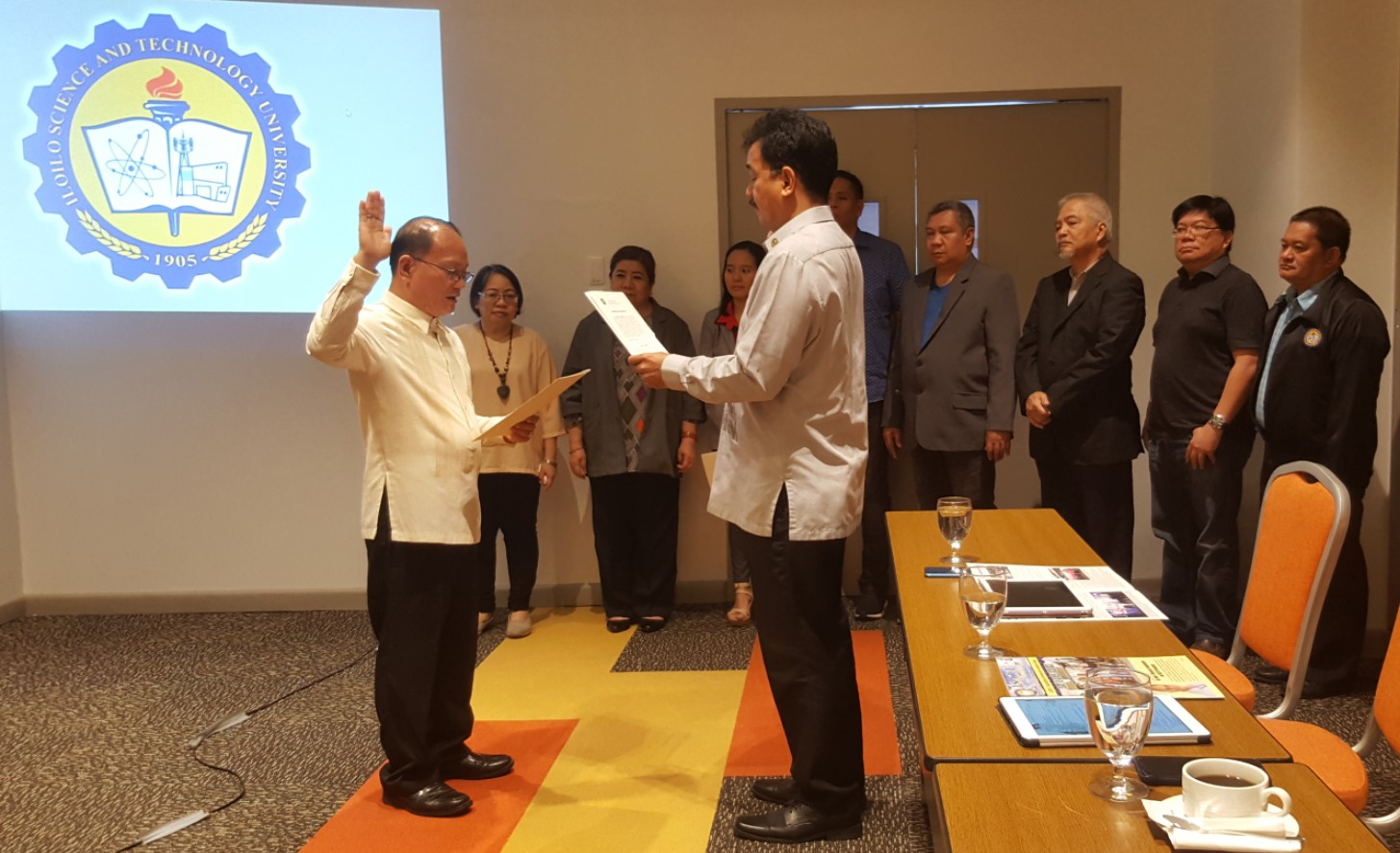 CHEd Chair J. Prospero E. De Vera III administers the oath of office of Dr. Raul F. Muyong for his second term as ISAT U President during the 4th Quarter Board Meeting at  Park Inn by Radisson Hotel, Iloilo on December 22, 2019.   Witnessing the ceremony are the members of ISAT U Board of Regents.