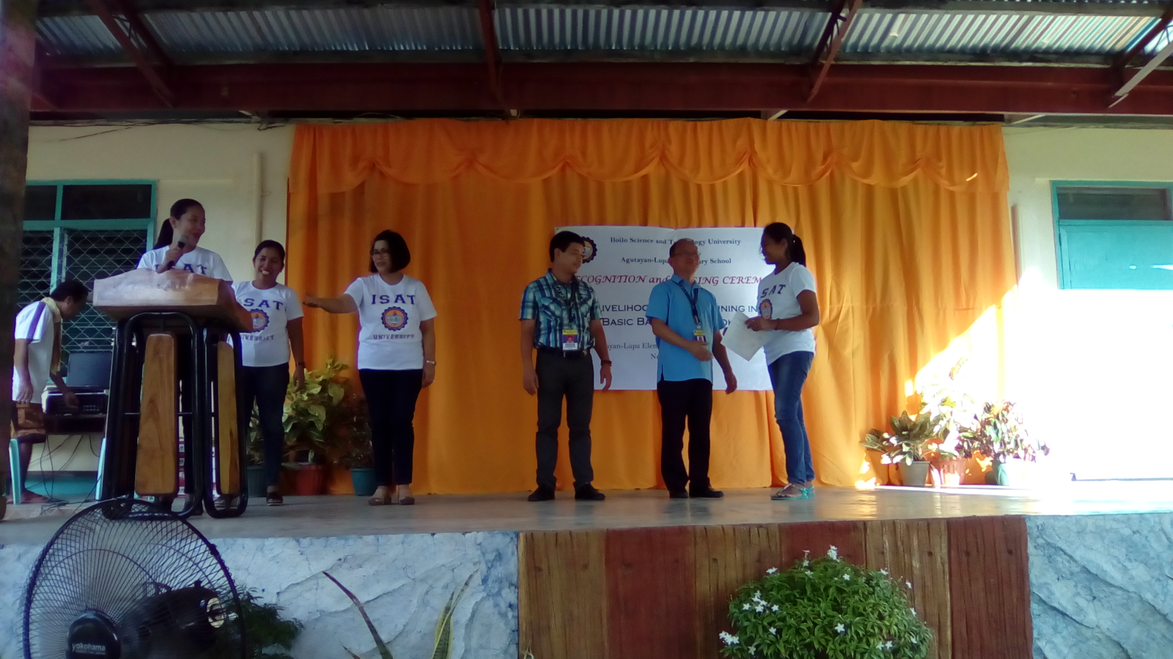 The participants receive the certificate during the culminating activity at Agutayan-Lupa Elementary School after completing the 10-day skills training.