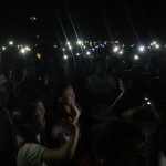 All lights were turned off except for the mobile phones while waiting for the countdown.