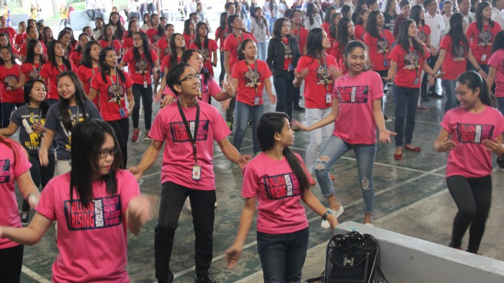"Dancing to the tune of ""Isang Bilyon"", the students join in 1 Billion Rising Revolution solidarity against exploitation of women."