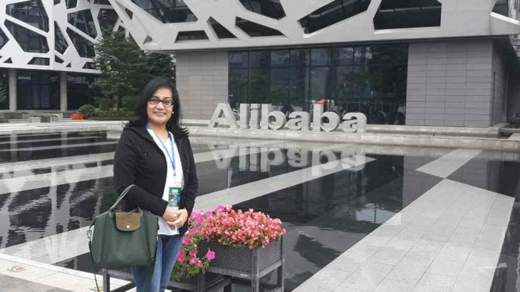 Dr. Misola at the entrance of Alibaba Office.