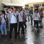 Students, faculty and staff line up to the evacuation center.