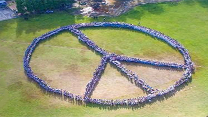 The Human Peace Sign at the ISAT U Football Field.