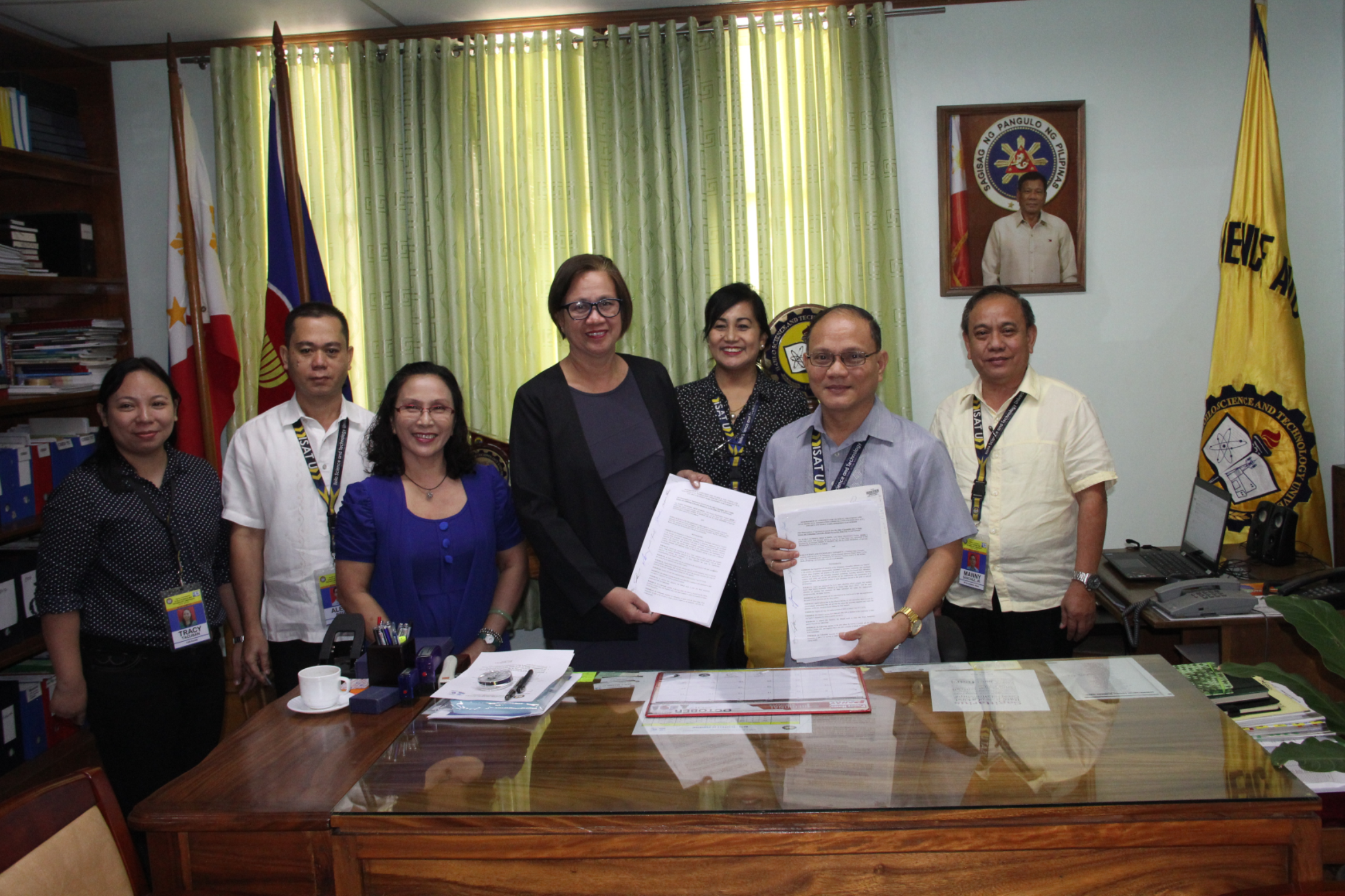 Dr. Raul F. Muyong and Dr. Maria Almen G. Gasalao, ASP-SHS, Iloilo National High School present the Memorandum of Agreement for study immersion of Iloilo National High School students at ISAT U Computer Department. Also in photo are (from left) Dr. Tracy Tacuban, Head, Computer Dept. ; Dr. Alejo P. Biton, CAS Dean; Dr. Evelyn M. Sorolla, INHS Focal Person/TVL Coordinator; Dr. Nehema K. Misola, VPEA and  Dr. Manuel A. Sanchez, Jr., VPAA.