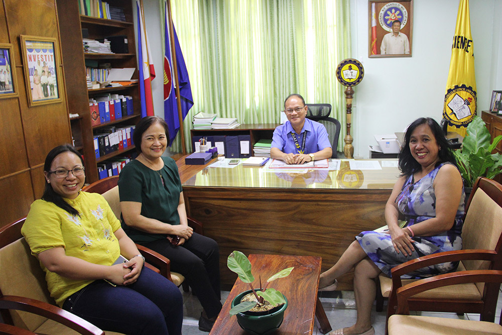 Dr. Evelyn C. Cruzada, (2nd from left) Asst. Sec. of the Office of the Cabinet Secretary, Office of the President, takes time to visit the office of Dr. Raul F. Muyong during the two-day user's training on the use of     e-MPATHY (Electronic Monitoring Platform Accountability and Transparency Hub for Yolanda). The training of the Inter-Agency Task Force on the unified implemented and monitoring of rehabilitation and recovery programs in the Yolanda Corridor was hosted by ISAT U. Before her appointment in the cabinet, ASEC Cruzada served as president of Leyte Normal University. Also in photo are Prof. Tracy N. Tacuban and Prof. Rossana R. Dureza.