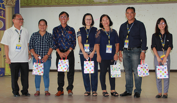Dr. Raul F. Muyong gives the token of  recognition to administrative personnel who have the  most number of attendance in the flag ceremony for 2018.  From left,  Laura H. Hitoriaga, Mr. Bonnie S. Arenal, Ms. Eva C. Sonza, Ms. Celine Samis, Mr. Gregorio Onday and Ms. Lira Reyes.